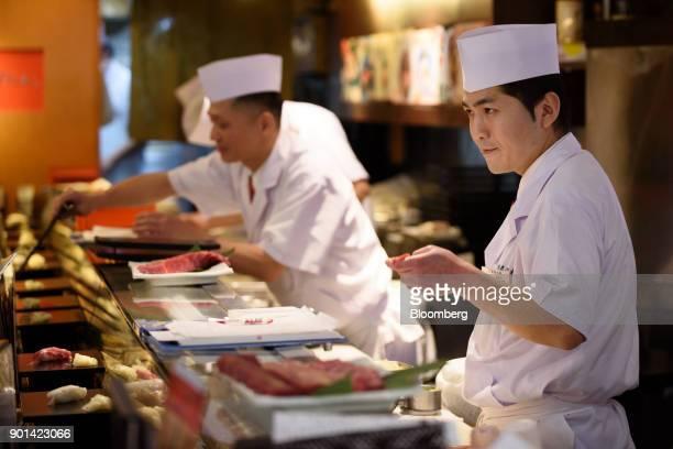 A sushi chef makes a piece of sushi at a Sushi Zanmai sushi restaurant in Tokyo Japan on Friday Jan 5 2018 Kiyomura KK operator of Sushi Zanmai...