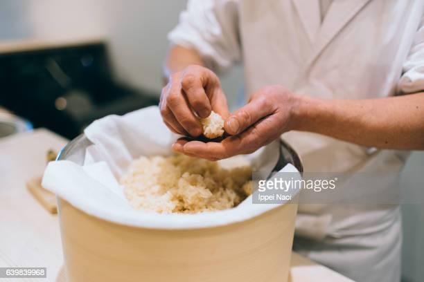 Sushi chef making artisanal nigiri zushi at bar, Tsukiji