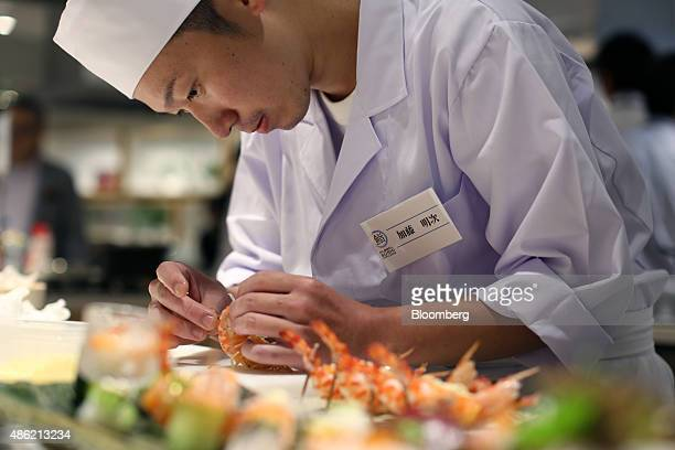 A sushi chef puts final touches on his creative sushi dish during the Global Sushi Challenge competition 2015 in Tokyo Japan on Wednesday Sept 2 2015...