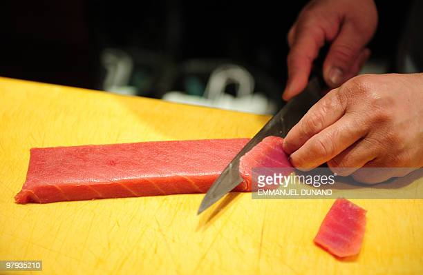 Sushi chef William Tawng prepares sushi and sashimi from a bluefin tuna at the upscale Japanese restaurant Megu in New York on March 10 2010 The...
