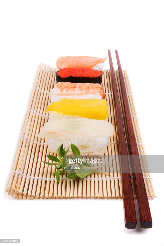 Sushi Green And Chopsticks On Bamboo Mat Stock Photo Getty