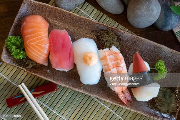 sushi mix on glazed tile dish japanese traditional food - nigiri stock pictures, royalty-free photos & images