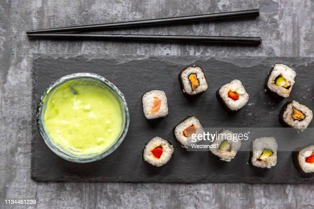 sushi on slabe plate, wasabi in bowl, chop sticks - wasabi stock pictures, royalty-free photos & images