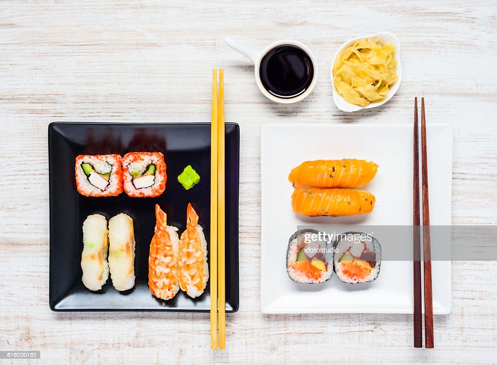 Sushi on Two Plates with Soy Sauce and Ginger : Stock Photo