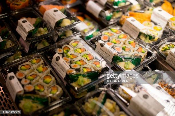 Sushi packed in sugarcane packaging is seen on sale at Budgens supermarket in Belsize Park, north London on July 2, 2019. - British supermarkets are...