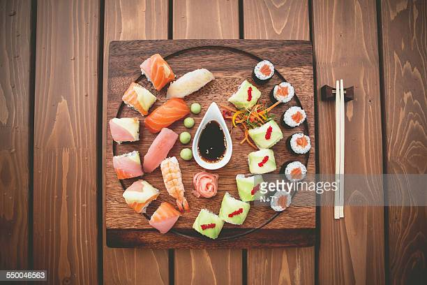 sushi plate - sushi restaurant stock photos and pictures