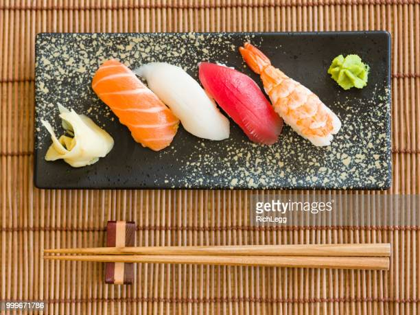 sushi plate - nigiri stock pictures, royalty-free photos & images