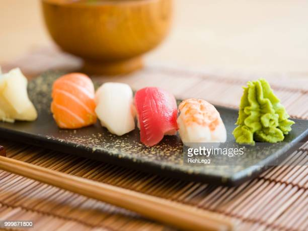 sushi plate - wasabi stock pictures, royalty-free photos & images