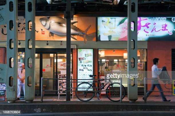 Sushi Restaurant Under the Railway Tracks in the Hibiya District of Chiyoda Ward in Tokyo, Japan