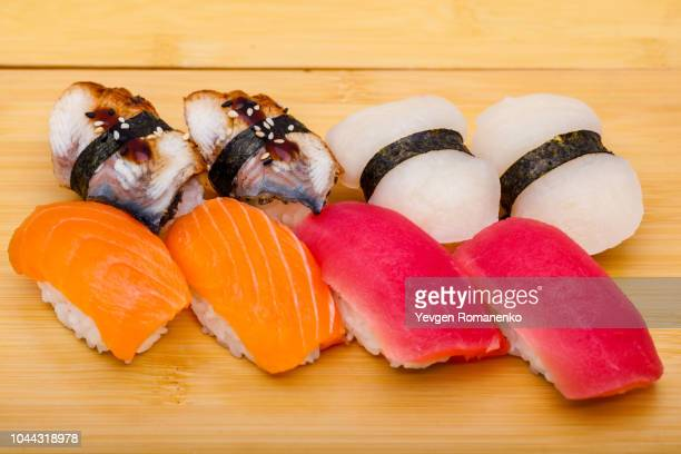 sushi roll set mix on wooden background - nigiri stock pictures, royalty-free photos & images