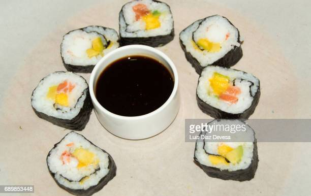 sushi rolls - soy sauce stock photos and pictures
