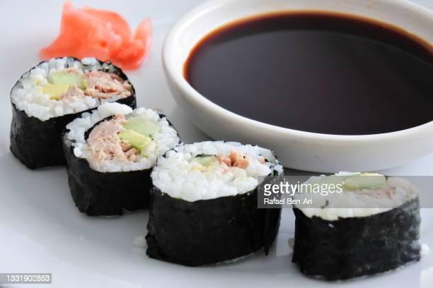 sushi rolls served on a white plate with soy sauce - rafael ben ari - fotografias e filmes do acervo