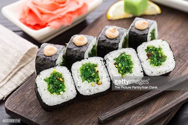 Sushi rolls with chuka salad