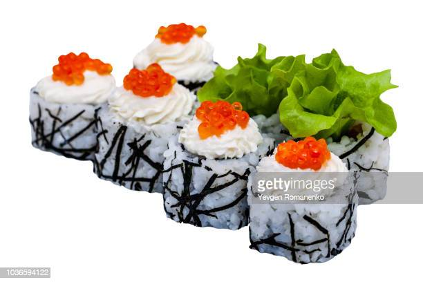 Sushi rolls with red caviar isolated on white background