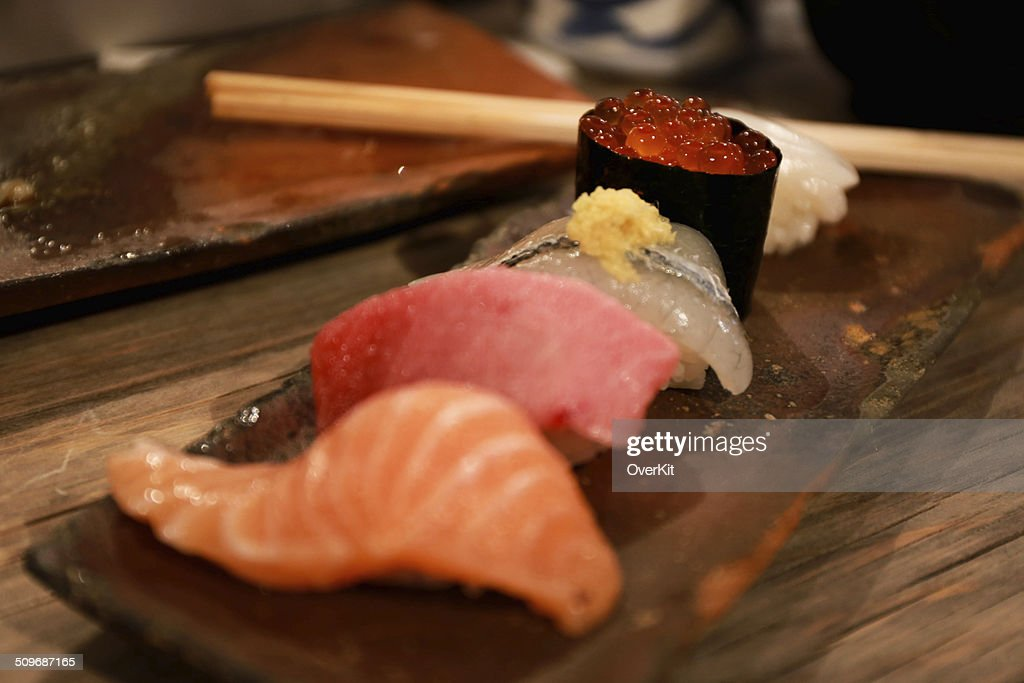 Sushi Salmon And Fish Eggs Stock Photo - Getty Images