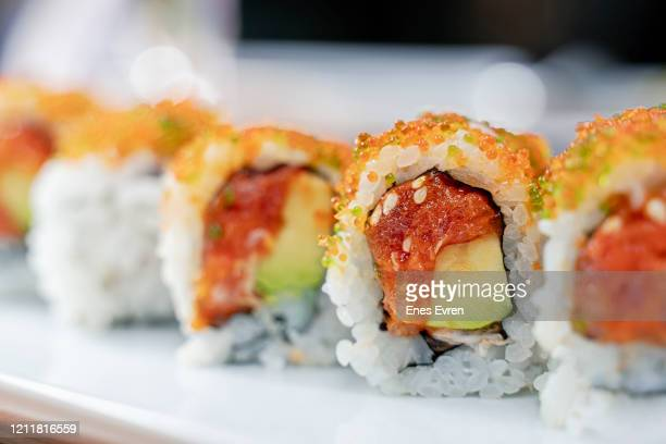 sushi salmon roll - extreme close up stock pictures, royalty-free photos & images