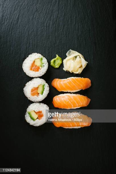 sushi served on plate on dark table - wasabi stock pictures, royalty-free photos & images