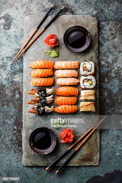 Sushi Set for two served on gray stone slate on metal background