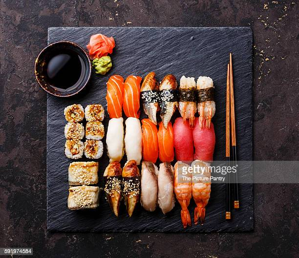 Sushi Set nigiri and sushi rolls on black stone slate plate board