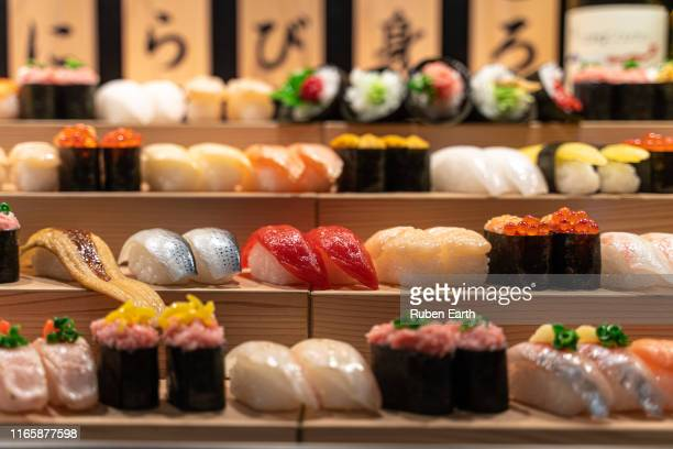 sushi stand on a restaurant - sashimi stock pictures, royalty-free photos & images