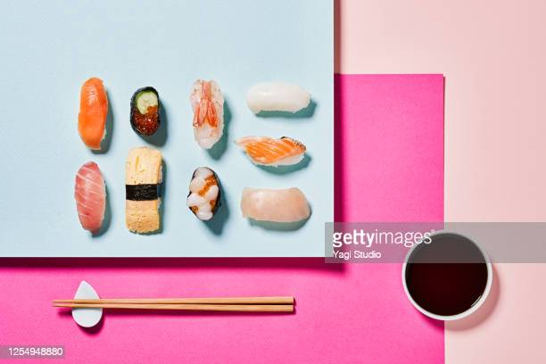 sushi with a colorful background - sushi stock pictures, royalty-free photos & images