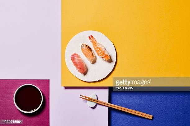 sushi with a colorful background - japanese food stock pictures, royalty-free photos & images