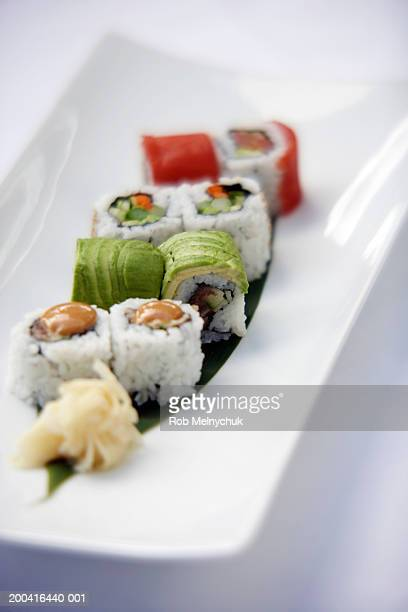 sushi with avocado and salmon, elevated view - pickled ginger stock pictures, royalty-free photos & images