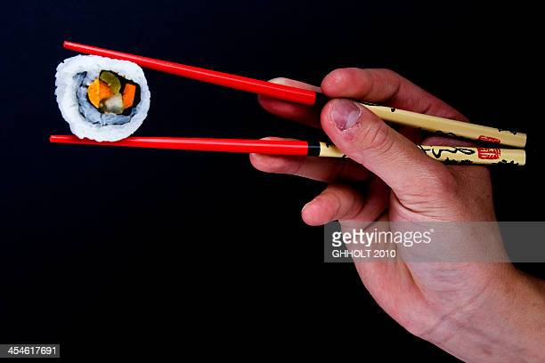 Sushi with chop sticks