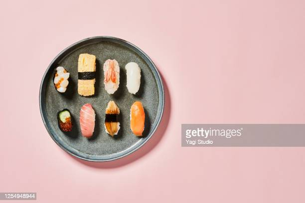 sushi with pink background - 多様性  ストックフォトと画像