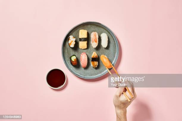 sushi with pink background - sushi stock pictures, royalty-free photos & images