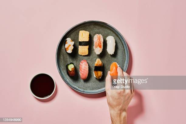 sushi with pink background - japanese food stock pictures, royalty-free photos & images