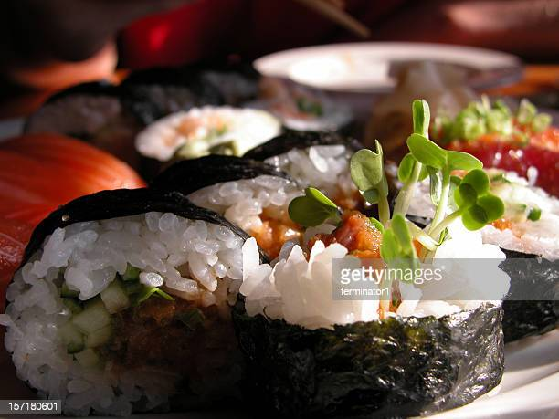 sushi with rice and seafood together - nori stock photos and pictures