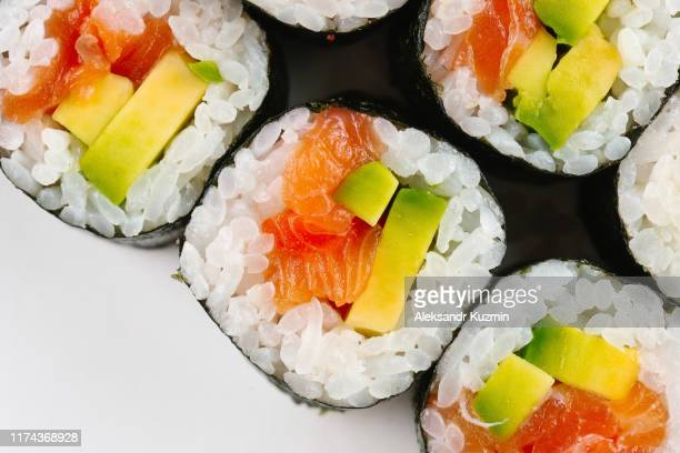 sushi with salmon and avocado - sushi stock pictures, royalty-free photos & images