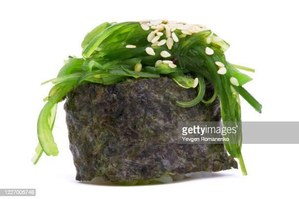 sushi with seaweed isolated on white background - 藻 ストックフォトと画像