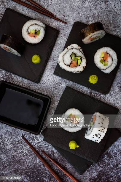 sushi with sticks - wasabi sauce stock pictures, royalty-free photos & images
