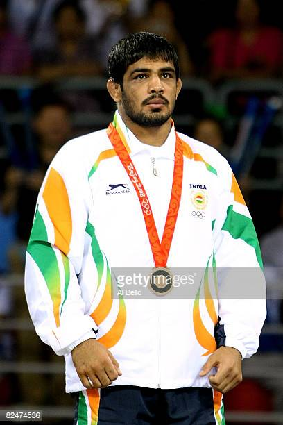 Sushil Kumar of India celebrates his bronze medal in the 66kg Men's Freestyle wrestling at the China Agriculture University Gymnasium during Day 12...