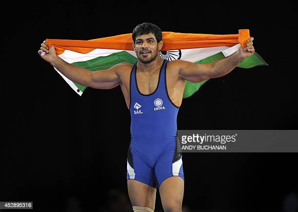 Sushil Kumar of India celebrates winning the men's 74kg freestyle Wrestling gold medal match at the 2014 Commonwealth Games in Glasgow Scotland on...