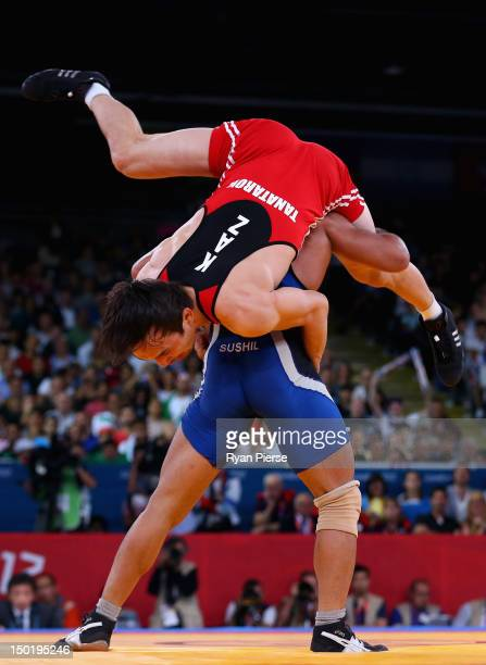 Sushil Kumar of India in action against Akzhurek Tanatarov of Kazakhstan during the Men's Freestyle Wrestling 66kg semi final match on Day 16 of the...