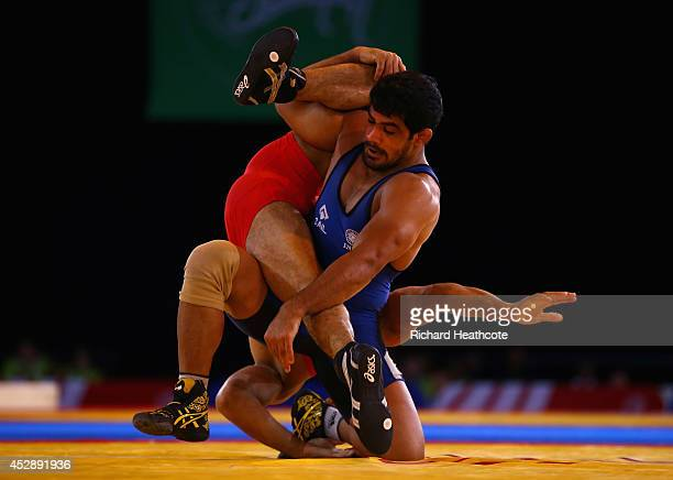 Sushil Kumar of India on his way to beating Qamar Abbas of Pakistan in the 74kg Freestyle Wrestling Gold medal match at Scottish Exhibition And...