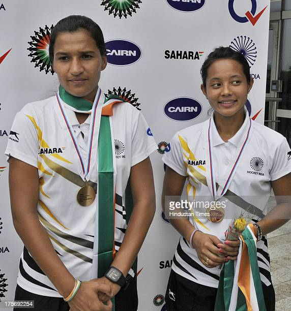 Sushila Chanu captain and Rani Rampal player of Indian Women's Junior Hockey team which won bronze medal at Junior Hockey World Cup pose with their...