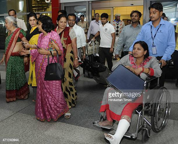 Sushila Jain Manju Bhadudai and Suman Natha with family members in happy mood after being evacuated from earthquake hit Nepal arrive at the T3...