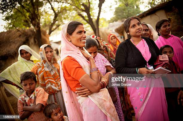 Sushila Mauria the head of Gulabi Gang's Fatehpur region is being briefed by local members of the gang regarding their current situation The Gulabi...