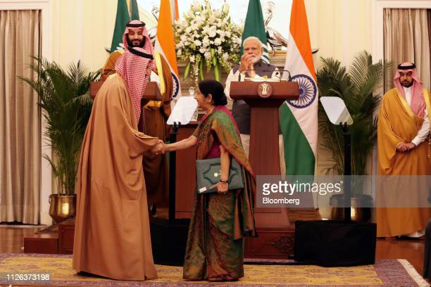 Sushma Swaraj India Minister of External Affairs front right shakes hands with a memeber of Saudi Arabia's delegation as Mohammed Bin Salman Saudi...