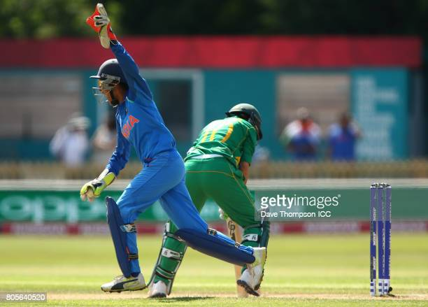 Sushma Verma of India celebrates catching out Bibi Nahida of Pakistan during the ICC Women's World Cup match between India and Pakistan at The 3aaa...