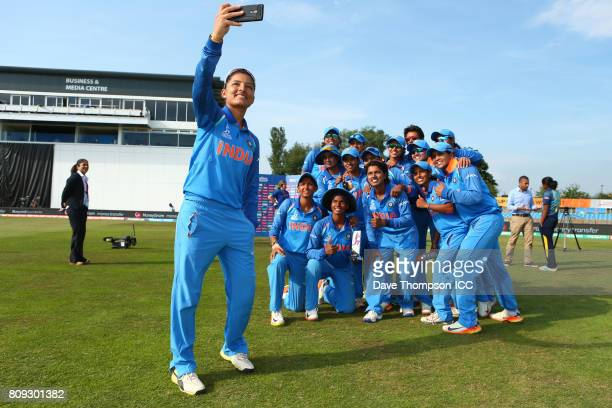 Sushma Verma of India takes a selfie with team mates following the ICC Women's World Cup match between Sri Lanka and India at The 3aaa County Ground...