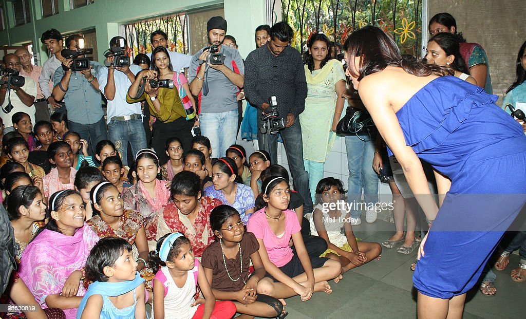 Sushmita Sen gestures as she meets with children and staff at The Bal Bhavan Shradha Vihar Society of the Helpers of Mary in Mumbai on April 22, 2010.