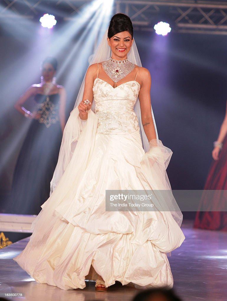 Sushmita Sen walks the ramp during a fashion show organised by India International Bullion Summit showcasing exquisite jewellery.