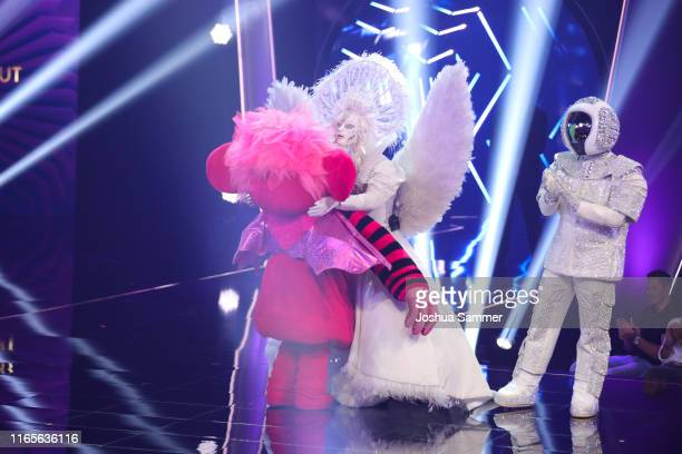 Susi Kentikian Buelent Ceylan and Max Mutzke at the The Masked Singer finals at Coloneum on August 01 2019 in Cologne Germany