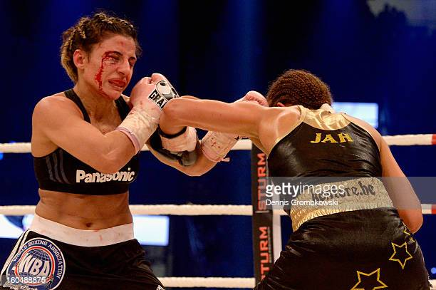 Susi Kentikian of Germany and Sanae Jah of Belgium box during WBA Flyweight World Championship fight at ISS Dome on February 1, 2013 in Duesseldorf,...