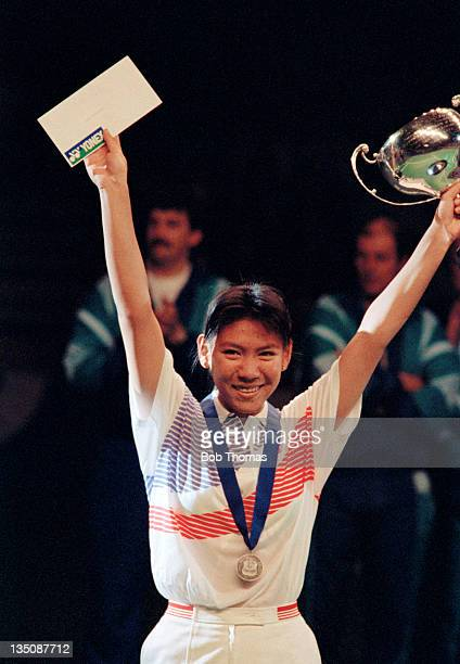 Susi Susanti of Indonesia with the trophy after winning the Women's All England Badminton Championship at Wembley Arena in London circa March 1990